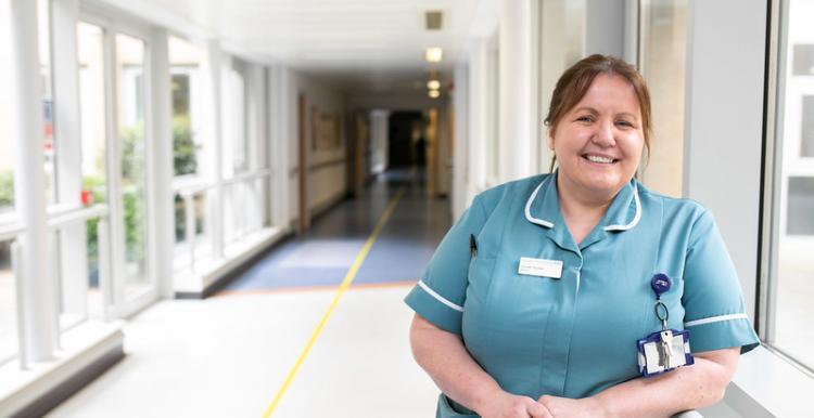 Female carer in hospital environment