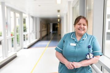 Female carer in hospital environment