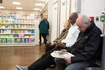 People waiting in a pharmacy