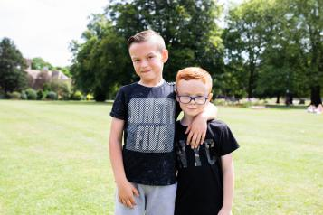Two boys outside looking athe camera