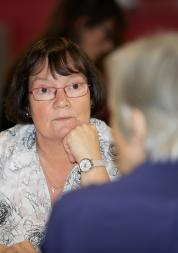 Woman sitting opposite someone in a conversation or meeting